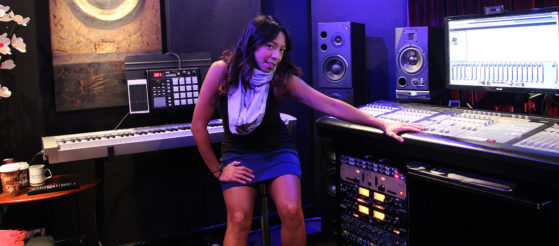 Naya Marie holding the mixing desk